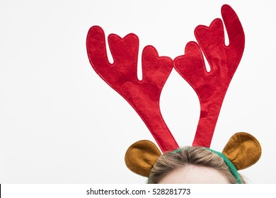 Festive christmas reindeer antler headband on a female head