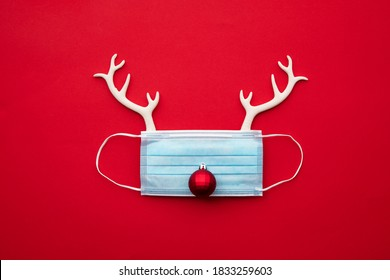 Festive christmas reindeer made from face mask and decorations - Shutterstock ID 1833259603