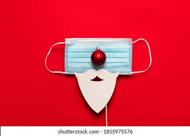 Festive christmas Santa Claus face made from face mask and decorations - Shutterstock ID 1855975576