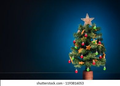 festive Christmas tree on blue background