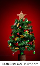 festive Christmas tree on red background
