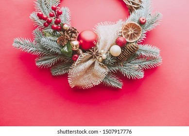 Festive Christmas wreath on a red background.