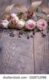 Festive close up flower English rose, lavender composition with ribbon on wooden background. Overhead top view, flat lay. Copy space. Birthday, Mother's, Valentines, Women's, Wedding Day concept.