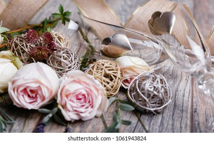 Festive close up flower pink English rose, lavender composition, glasses of champagne, silver heart on wooden background. Overhead top view, flat lay. Copy space. Valentines, Wedding Day concept.