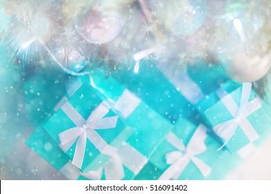 Festive color boxes Tiffany near the Christmas tree