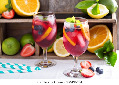 Festive and colorful summer sangria with citrus fruit and blueberry
