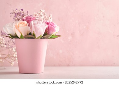 Festive composition with beautiful delicate roses flowers in pink round box on light pink background. Happy Mothers Day Greeting card. Square image.