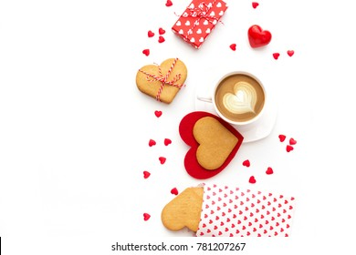 Festive composition with cookies in shape of heart, gift box and hearts. Valentine's day background isolated in white