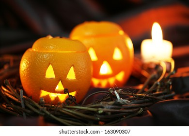 Festive composition with lanterns and candle on dark fabric background