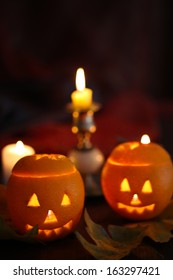 Festive composition with lanterns and candles on dark background