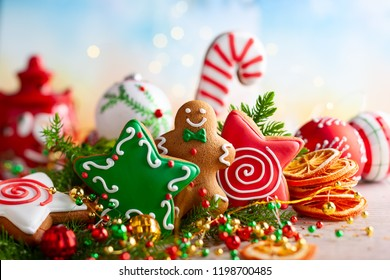 Festive concept with Christmas gingerbread cookies, fir branches and winter spices.