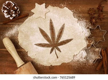 Festive cookie dough with the shape of a weed leaf cut out (series)