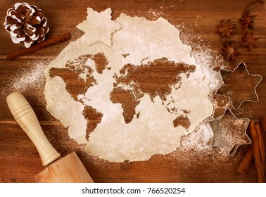 Festive cookie dough with the shape of the world cut out (series)