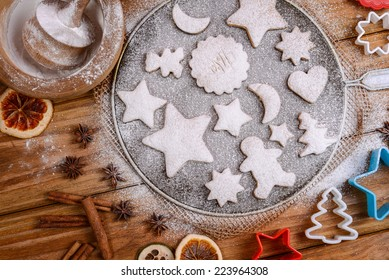 Festive cookies decorated on rustic table with spices