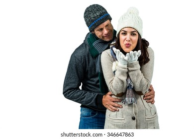 Festive couple in winter clothes on white background