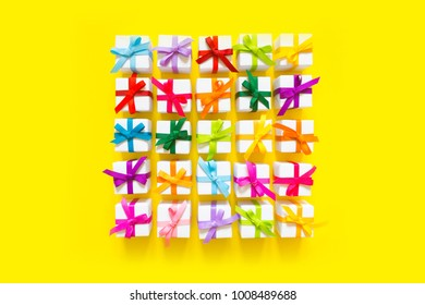 Festive decor square. Ribbons for gifts of rainbow color, spectrum.