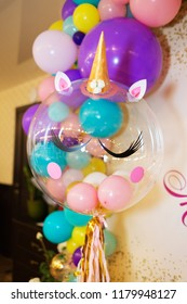 Festive decor in the style of a unicorn. Large transparent balloon unicorn style.