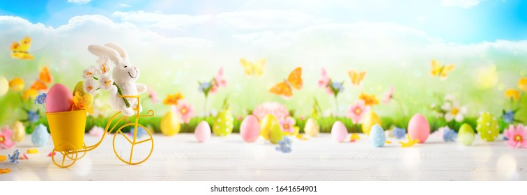 Festive decoration with Easter eggs, Bunny and beautiful spring flowers. Easter concept with copy space.