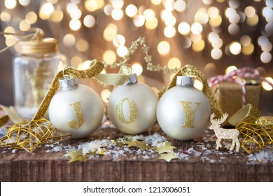 Festive decorations with Christmas baubles in front of cheerful lights
