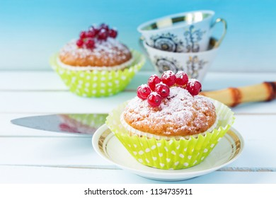 A festive dessert with red berries and powdered sugar. Cake with berries. Close-up. Copy space.