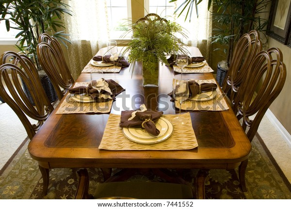 Festive dining table with luxurious accessories and decor.
