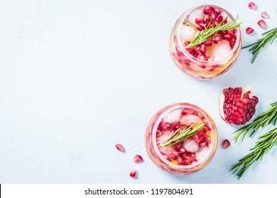 Festive drinks, citrus, pomegranate cocktail. Selective focus, space for text.