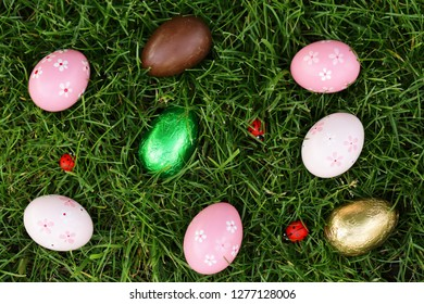 festive easter eggs on green grass