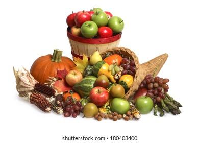 Festive fall still life with cornucopia, pumpkin, and basket of apples