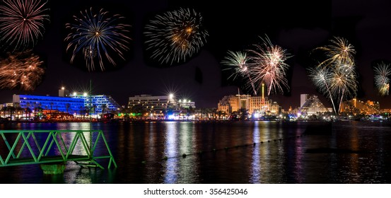 Festive firework in Eilat. In Israel, Eilat is a perfect vacation spot suitable for diving, partying, shopping and relaxing by swimming in the Red Sea or pools in luxurious hotels