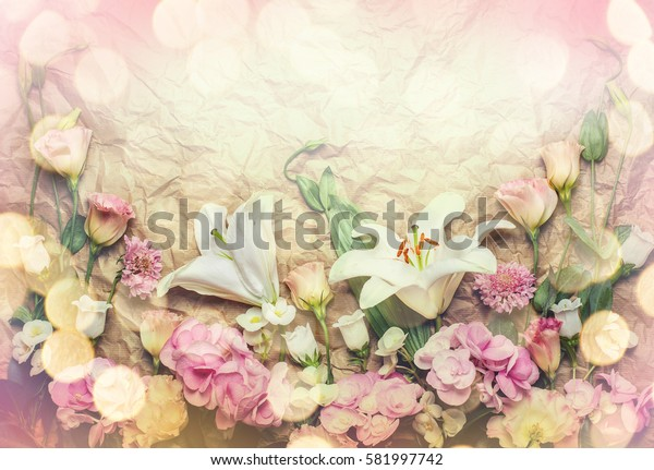 Festive flower composition on the crumpled paper background. Top view.