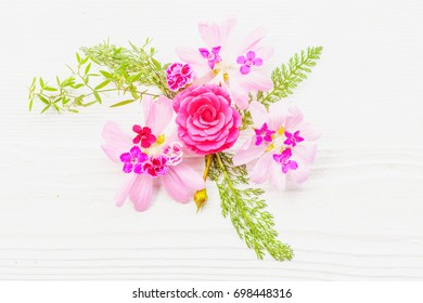 Festive flower composition on the white wooden background. Overhead view.
