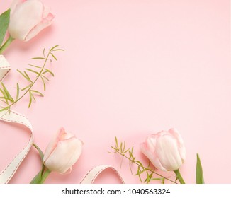 Festive flower pink tulips composition on the light pink background. Overhead top view, flat lay. Copy space. Birthday, Mother's, Valentines, Women's, Wedding Day concept.