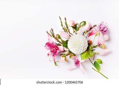 Festive flower white dahlias, pink fuchsia composition on the white background. Overhead top view, flat lay. Copy space. Birthday, Mother's, Valentines, Women's, Wedding Day concept.