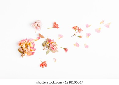 Festive flowers composition. Frame made of dried rose flowers, on white background. Overhead top view, flat lay. Copy space. Birthday, Mother's, Valentines, Women's, Wedding Day concept