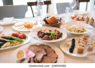 festive food on white table at restaurant