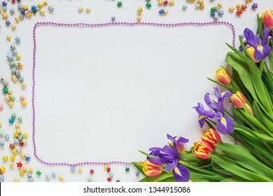 Festive frame of a bouquet of flowers and stars
