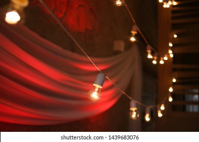 festive garland decor with retro bulbs light ceiling awning terassa