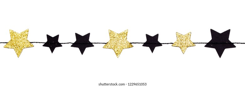 Festive garland pennant with Golden black stars in a row isolated on white