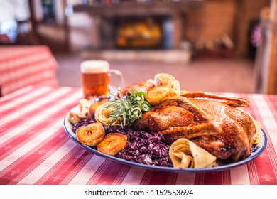 Festive garnished roast duck with apples and red cabbage.