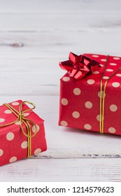 Festive gift boxes background. Christmas gifts on white wooden table. Happy holiday concept.