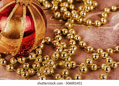 festive gold christmas decorations on a fabric background hdr filter