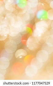 festive golden abstract background with light bokeh, vertical