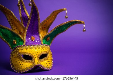 Festive Grouping of mardi gras, venetian or carnivale mask on a purple background