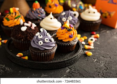 Festive Halloween cupcakes and treats decorated with sprinkles and candy