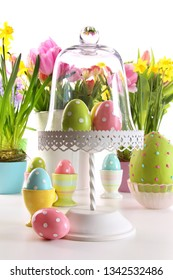 Festive holiday table with fresh flowers and Easter eggs