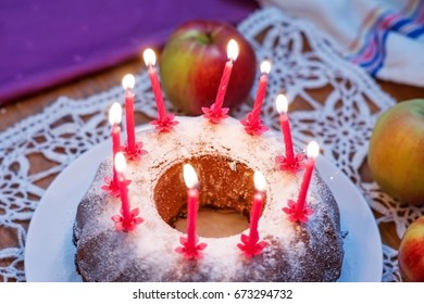 Festive home-made cake with candles. - Shutterstock ID 673294732