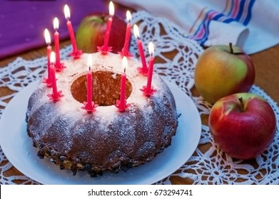 Festive homemade cake with candles and apples on the table. - Shutterstock ID 673294741