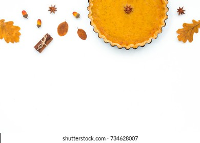 Festive homemade pumpkin pie on white background. Flat lay, top view. Thanksgiving Day