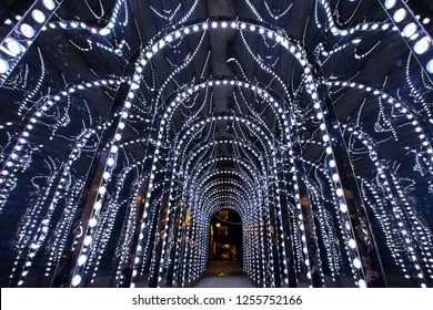 A festive illuminated walkway in Conduit Court in London, UK.
