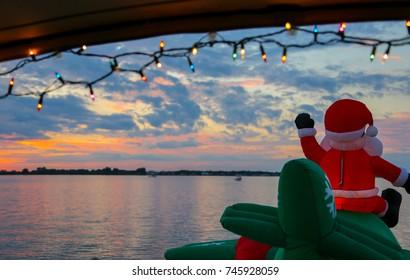 Festive Inflatable Santa Flies Into Florida Sunset